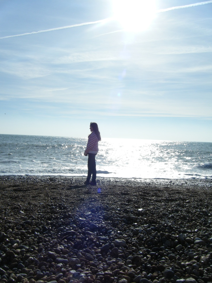 A very bright day.girl on Beach