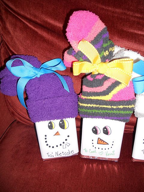 Fun socks and large candy bars made into snowmen.