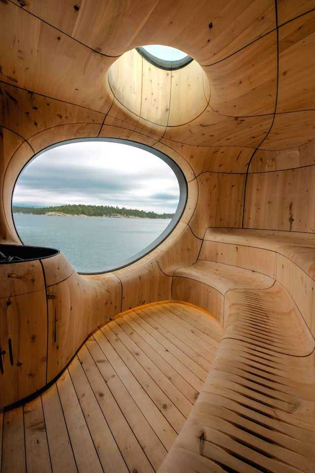 """Partisans has designed """"Grotto"""", an amazing sauna located in Ontario's nature, Canada, offering a wonderful view of the surrounding landscape. Its exterior structure, simple, minimalist and linear is so astonishing as its interior design, complex, featuring very elaborated shapes and ergonomics. To discover in images."""