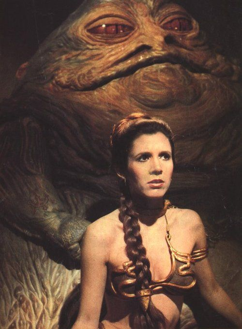 """Carrie Fisher as Princess Leia  and Jabba the Hutt in """"Star Wars Episode VI: Return of the Jedi"""" (1983)"""
