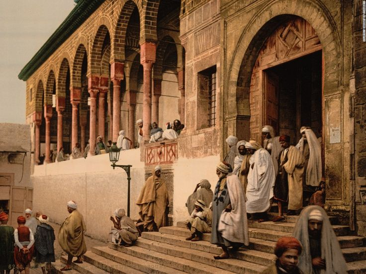 Men leaving a mosque in Tunis, Tunisia circa 1899. Captured using a photolithography method known as a photochrom, it was an early way to create color stills from a camera.