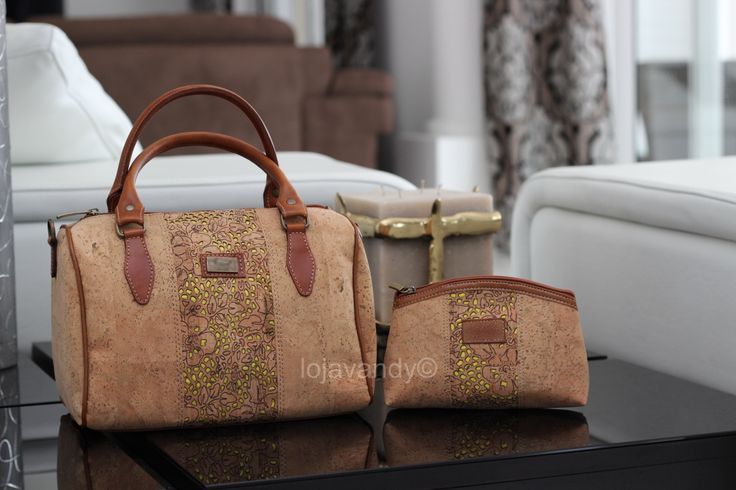 Purse and cosmetic bag in natural cork with ornaments made with laser, yellow accents and leather wings.