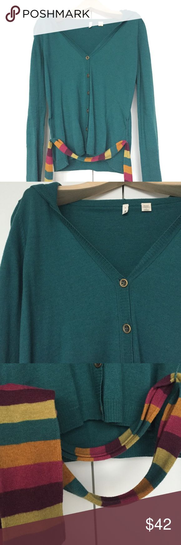 Turquoise Cardigan with Multicolor Belt and Hood This hooded turquoise cardigan has a bright multicolor belt attached that really pops! By Anthropologie brand Moth. V-neck with brass buttons down the front. In excellent condition, very slight pilling but otherwise has only been worn a few times. Anthropologie Sweaters Cardigans