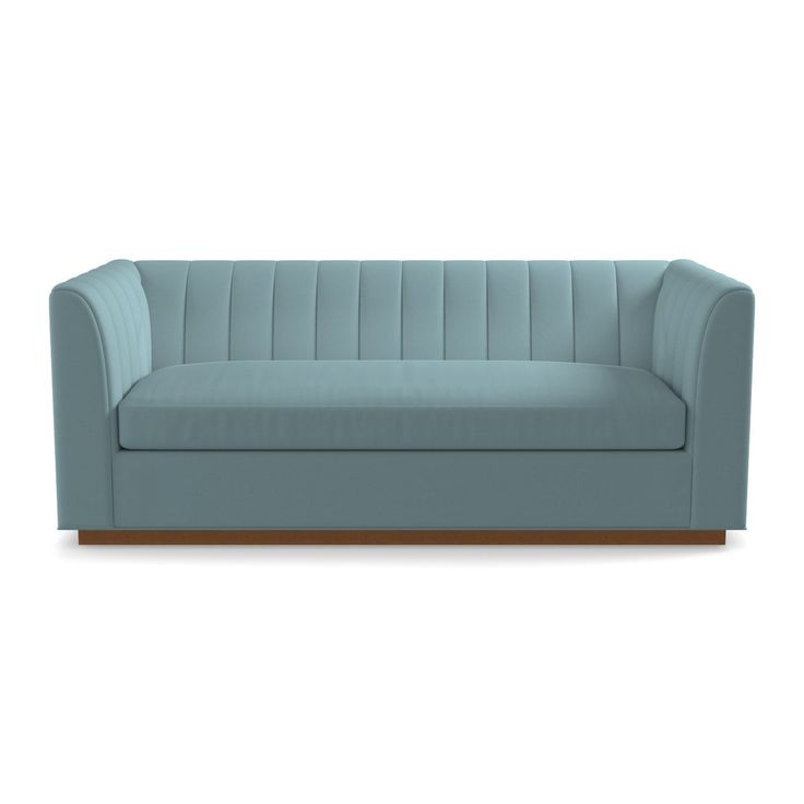 This sleek, and oversized sofahas a tight channel-tufted back that has an art deco flair with a modern silhouette. With high arms and a high back this chairenvelopes you like an old school restaurant booth but the deep seat has you staying for dessert. ALSO AVAILABLE AS A SLEEPER SOFA!