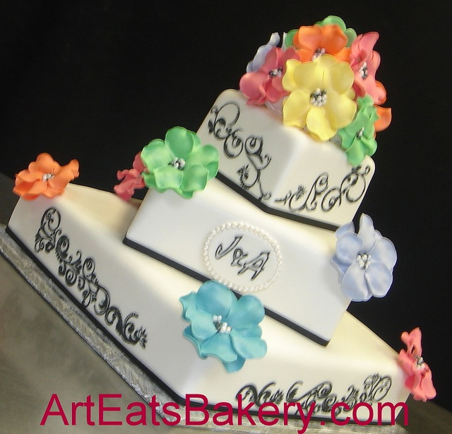 Tree tier black and white fondant square wedding cake with rainbow colored sugar flowers by arteatsbakery, via Flickr