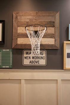 We LOVE this idea for dad's man cave, and it's so easy to DIY. Start with an old pallet and cut the pieces for a backboard. Attach a hoop and a fun sign and there you go!