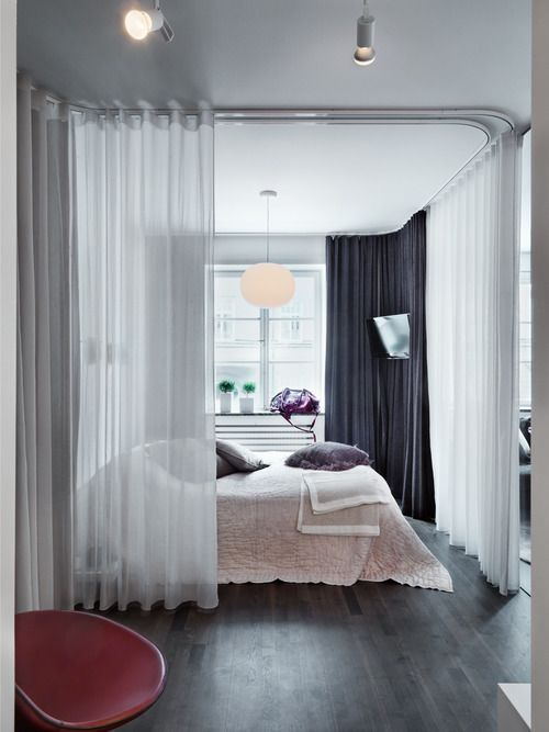 Sheer Curtains On Sliders Make A Cost Effective And Beautiful Room Divider