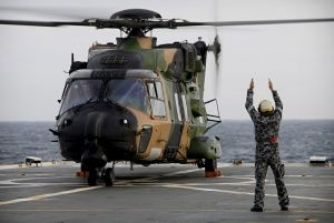 MRH 90 'Cobra 08' prepares to take off during the First of Class Flight Trials onboard HMAS Manoora.