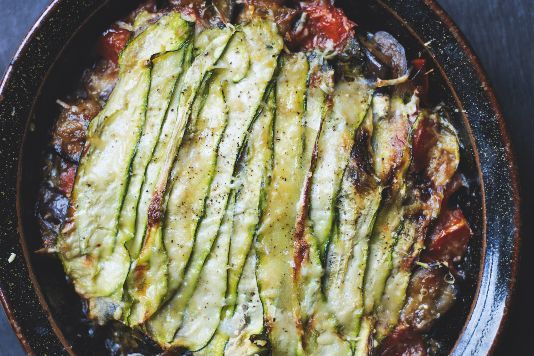 aubergine, courgette and basil gratin.     aubergines cut into cubes  courgettes  olive oil   red onion   thyme   6 garlic cloves, crushed   4 medium tomatoes (or tin chopped)  3 tbsp red wine vinegar  3 big handfuls of basil  50g grated parmesan