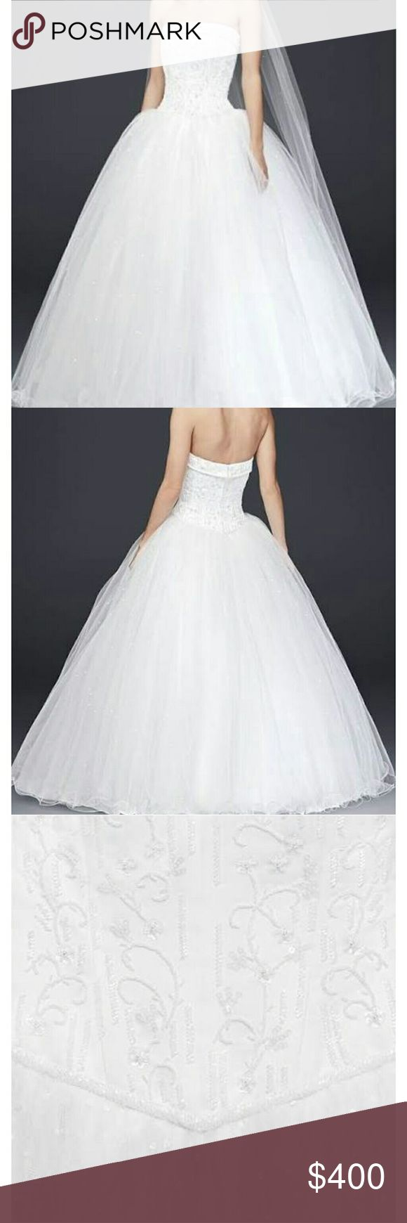 Tulle Wedding Dress with Corseted Satin Bodice Tulle Wedding Dress with Corseted Satin Bodice, white size 8. Channel your inner princess wearing this jaw-dropping strapless ball gown. With a beaded satin corset, cuff neckline, and beaded tulle skirt, a fantasy-come-true has never looked quite so elegant. David's Bridal Collection  Style:NT8017   Also available in my closet, is a matching veil. Never worn, just tried on in the store before purchased. Been in a garment bag ever since. David's…