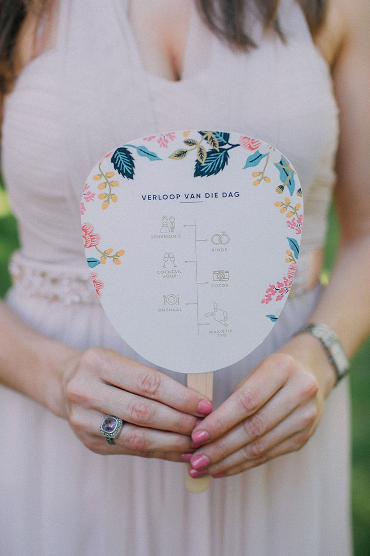 A cute idea of showing the events of the day on the wedding ceremony program that doubles as a fan. Beautiful floral wedding stationery ideas with soft pinks, turquoise and navy. Designed by the bride herself. For more of this boho garden wedding go to http://michelledt.com/hestre-johan/