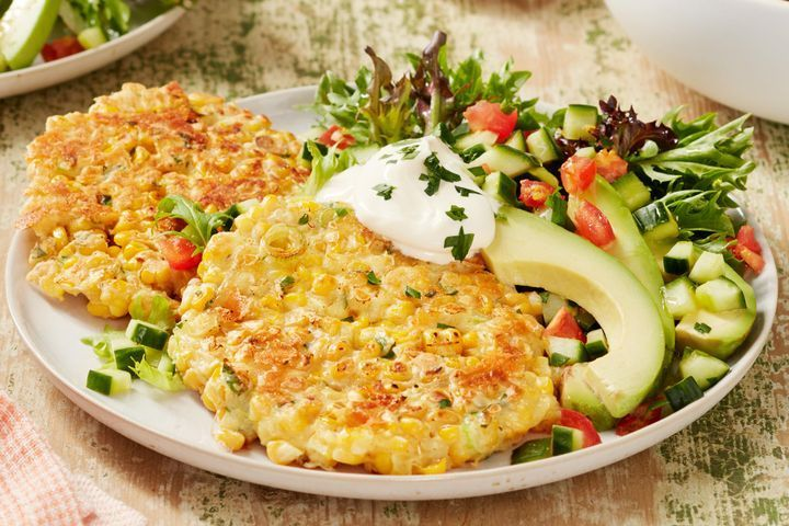 Corn fritters with lemony cucumber salad