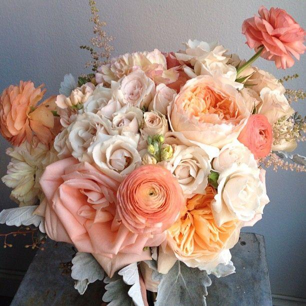 peach spray roses, garden roses, ranunculus, astilbe and dusty miller