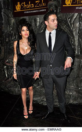 04.AUGUST.2010 - LONDON  AMY WINEHOUSE AND BOYFRIEND REG TRAVISS ATTEND THE…