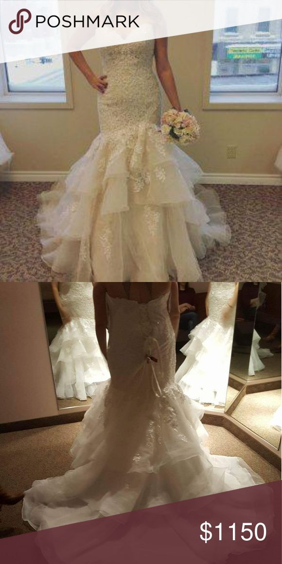 Ivory Wedding Dress Sadly, my dress was never worn. The first picture is a great one of the front. There is a corset back which you can see in the second photo which is the sample dress I tried on at the store which was a little too big. The dress I ordered has never been worn or altered. Still in dress bag with all the odds and ends. Gorgeous beading and a cathedral train! Size 20: the corset makes thr dress form fitting and looks great if you have hips and you want that hour glass figure…