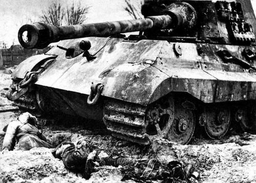 """Knocked-OutTiger II (""""King Tiger"""") in Pommerania, Eastern Germany, 1945 and dead crew. The tank was destroyed by Russian ISU 152"""