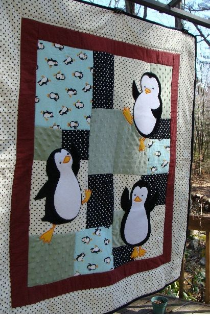Frolicking penguins grace this gender neutral baby quilt. Polka dot and penguin flannel prints mix with deliciously soft minkee (dotted of