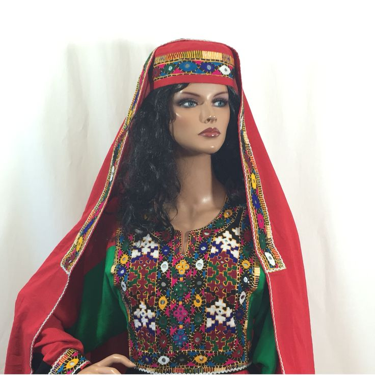"""Shagufa Afghan Kuchi Tribal Dress http://www.zarinas.com/dresses2.shtml  Beautifully embroidered traditional Afghan Kuchi tribal dress. The material is soft, breathable, and light weight - perfect for the summer! Comes with matching pants, head scarf, hat and adjustable belt at the waist. The measurement of the bust is 21"""" from seam to seam, and the length is 57"""" long from the back. Color: Blue. Size: X- Large to XX-Large (Depending on bust size)  Price: $109.00 Product ID: 9FEB16SHAGUFA"""