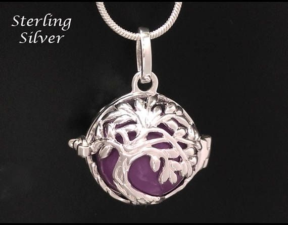 Chiming Tree of Life Necklace, Sterling Silver Celtic Tree of Life Necklace with Purple Harmony Chime Ball found at www.treeoflifejewellery.com and https://www.etsy.com/shop/MyTreeOfLifeJewelry  #treeoflife #treeoflifejewelry #treeoflifenecklace #chimingtreeoflifenecklace