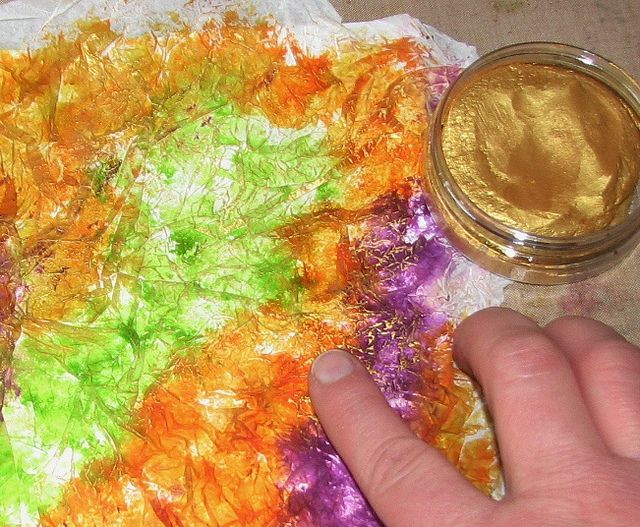 glue crumpled tissue paper to cardstock, ink, then apply metallics rub-ons