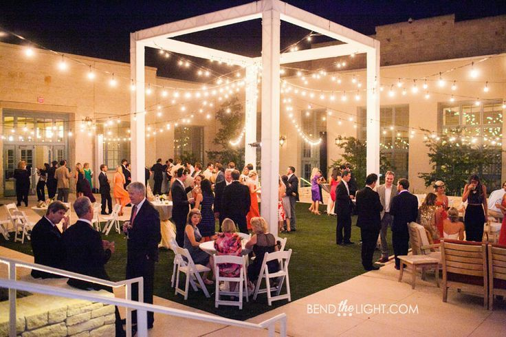 A beautiful cocktail wedding reception at one of our outdoor wedding venues! The twinkling lights and the Texas stars overhead provide the perfect ambience to this lovely evening.