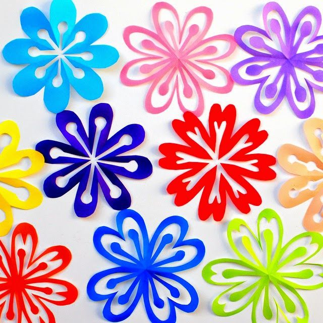 Pink Stripey Socks: How to Make Colorful Kirigami Flowers-- not sure if this would work for kids because of the scissors, but it could be a fun decoration for 60s night