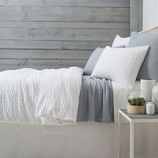 """Like a favorite pair of perfectly worn jeans, this deconstructed, superlightweight matelassé coverlet in a faded denim hue is ideal for spending long, lazy mornings under the covers. (Go ahead—we wont tell!) Perfect for sleek urban rooms when paired with tailored sheets, shams, and bed skirts, or for an upscale country look when combined with a pretty floral and a splash of saturated color.    • 100% cotton.  • ½"""" hem on top edge, 2"""" hem on 3 sides.  • Mitered..."""
