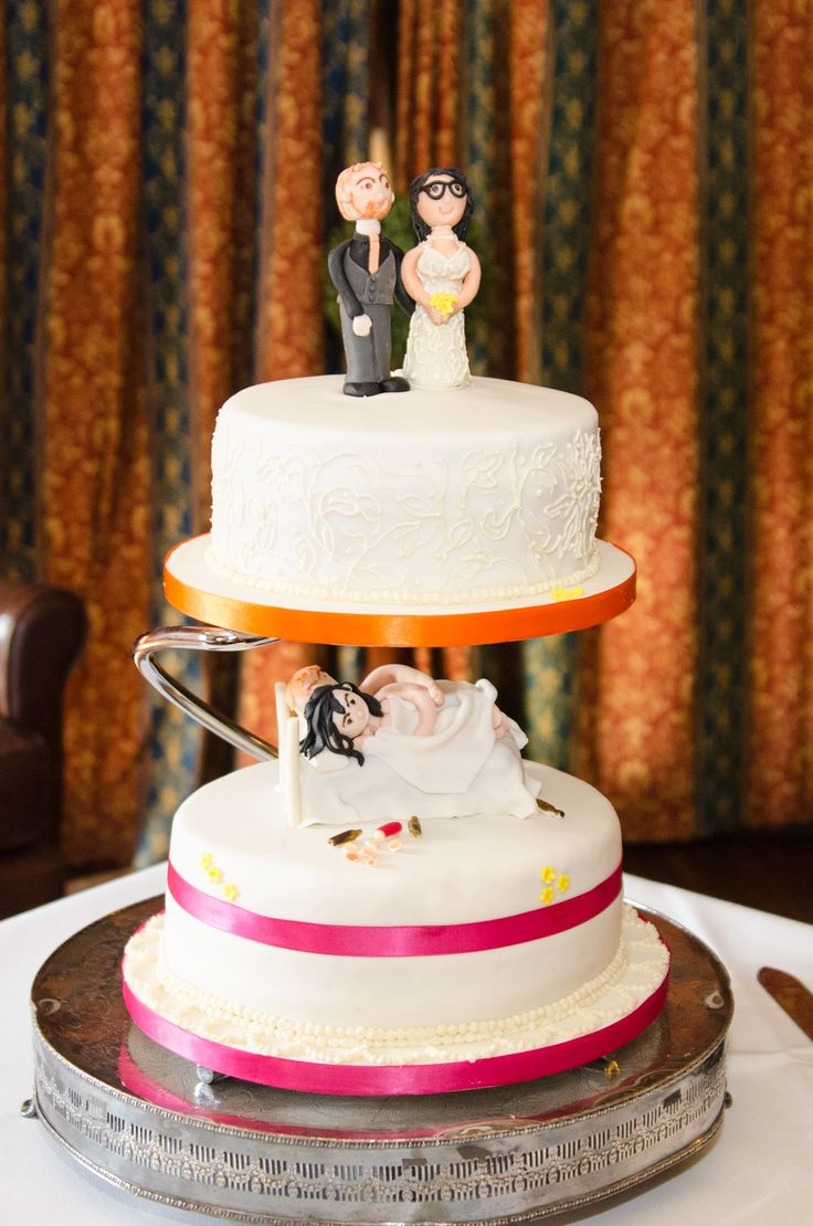 Two tier wedding cake with quirky personalised topper