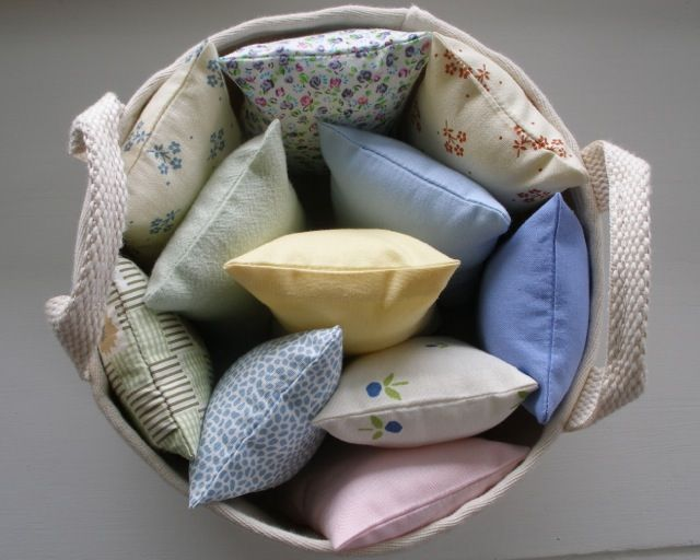 dolls' pillows in a large display bowl