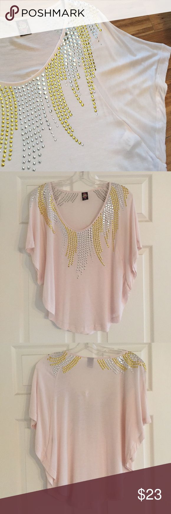 Free People Blush Pink Batwing Top w/Metal Detail Blush pink batwing top with dolman sleeves and gold & silver metal studs around neckline.  Drapey and gorgeous on!  This top gives an exclamation point to any outfit!  Gently worn with one small spot on front (see photo).  100% viscose. Free People Tops Tees - Short Sleeve