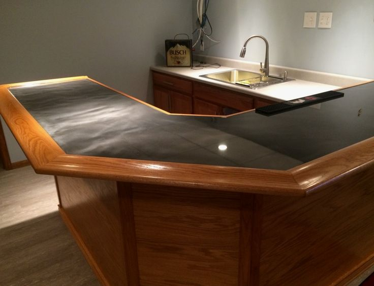This One Features A 45 Degree Angled Corner With A Metallic Epoxy Bar Top  Trimmed With Our Bar Rail Molding In Red Oak.