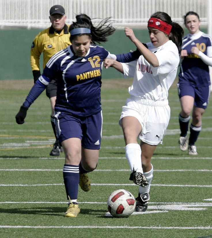 RoundL Lake player Jackie Salgado battles Grant player Iony Schmidt for the ball in the first half during the girls high school soccer game Tuesday between Grant and Round Lake at Grayslake Central High School.