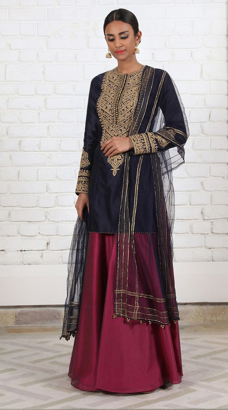 Rimple & Harpreet Narula. Navy blue Chanderi silk short kurti with delicate tilla-dori embroidery; paired with a soft tulle dupatta and ruby pink silk sharara.