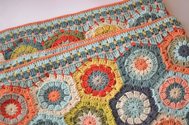 Gorgeous Hexagon blanket by Dover & Madden. Hexagon pattern by Attic24 here http://attic24.typepad.com/weblog/2008/11/hexagon-crochet.html Half hexagon by Rosa P. here http://rosa-r.blogspot.com.au/2010/10/how-to-make-half-hexagons.html And the tutorial for the border is here http://www.doverandmadden.blogspot.ie/2013/08/a-tutorial-of-sorts.html