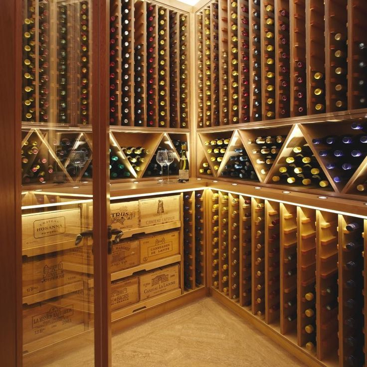 wine room lighting. do the bin style racks in middle a break up monotony of endless slots yes b hold more than as there is less wood and wine room lighting