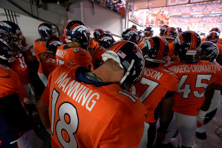 Denver Broncos quarterback Peyton Manning (18) waits to take the field before the game. The Denver Broncos took on the Baltimore Ravens in the first game of the 2013 season at Sports Authority Field at Mile High in Denver on September 5, 2013. (Photo by John Leyba/The Denver Post)-- #ProFootballDenverBroncos