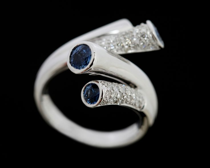 A spray of brilliant cut Sapphires and Diamonds in 18 carat white gold
