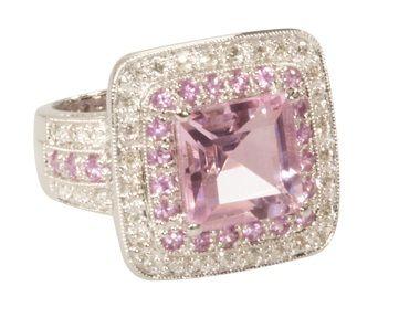 Pink quartz, sapphire, diamonds, and gold engagement ring.
