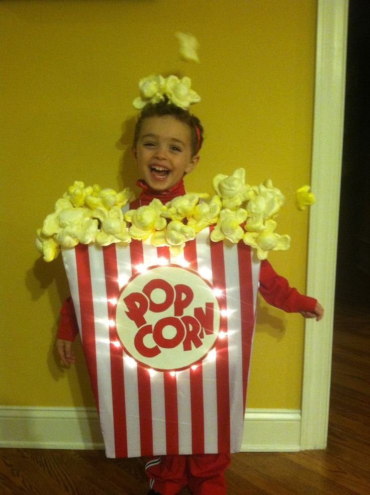 "Popcorn ""great stuff"" foam spray on a cylinder container with x's make popcorn kernels! What a neat idea!"
