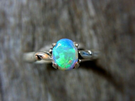 Sold to Hamburg Germany this 0.75 solid crystal opal from Lightning Ridge in a Sterling Silver setting. See all at gemniopals.com.au and click on Online Store.