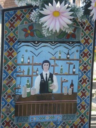 The gravestone of a bartender. Ioan Stan Patras, Cimitirul Vesel (The Merry Cemetery) - Săpânţa, Romania