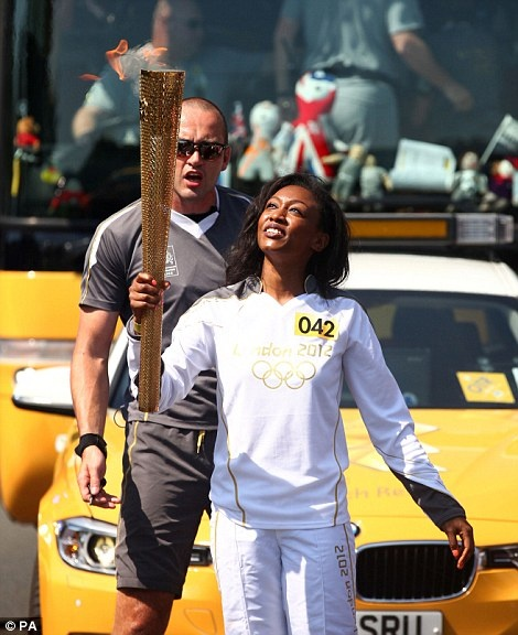 Musician Beverley Knight from Wolverhampton carries the Olympic flame through Brent on Day 68 of the relay