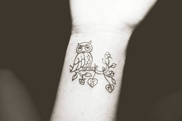 small owl wrist tattoo - have a letter for each child