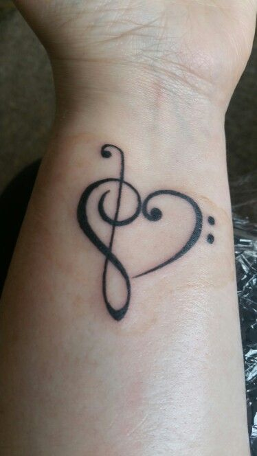 My Treble Cleft/Bass Cleft Heart formation tattoo :)