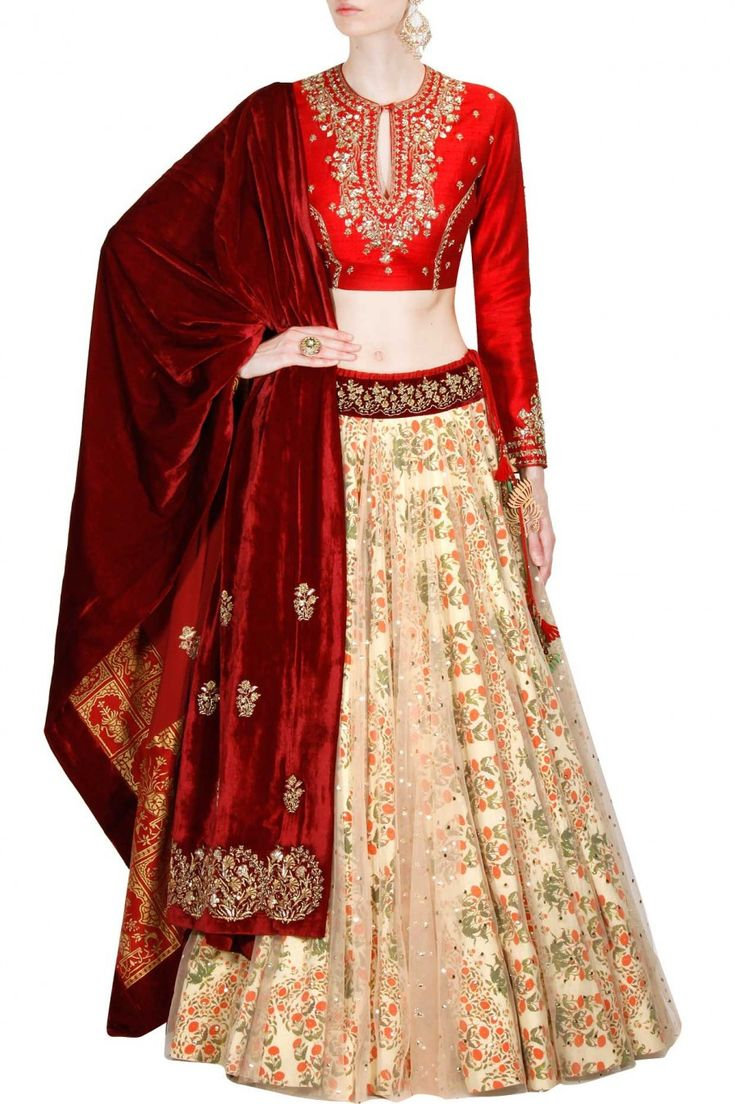 This set features a red full sleeves blouse in dupion base appliqued with floral gold and silver sequins embellishment, dori and dabka embroidery on the front a