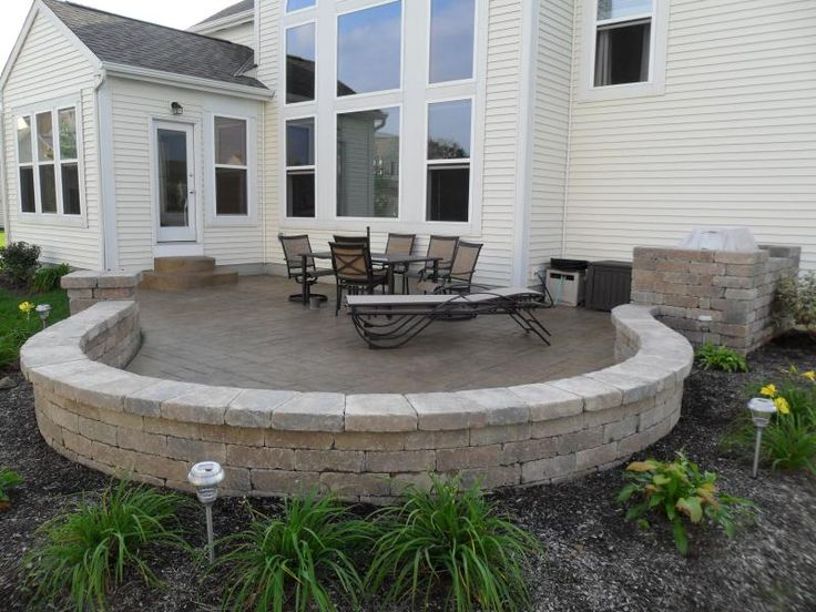 Stamped concrete patio picture with paver seating wall in Blacklick, Ohio.