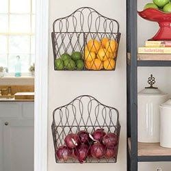 Hang magazine racks for a fruit basket to free up counter space, I wonder if kids would be tempted to eat more fruit this way:)