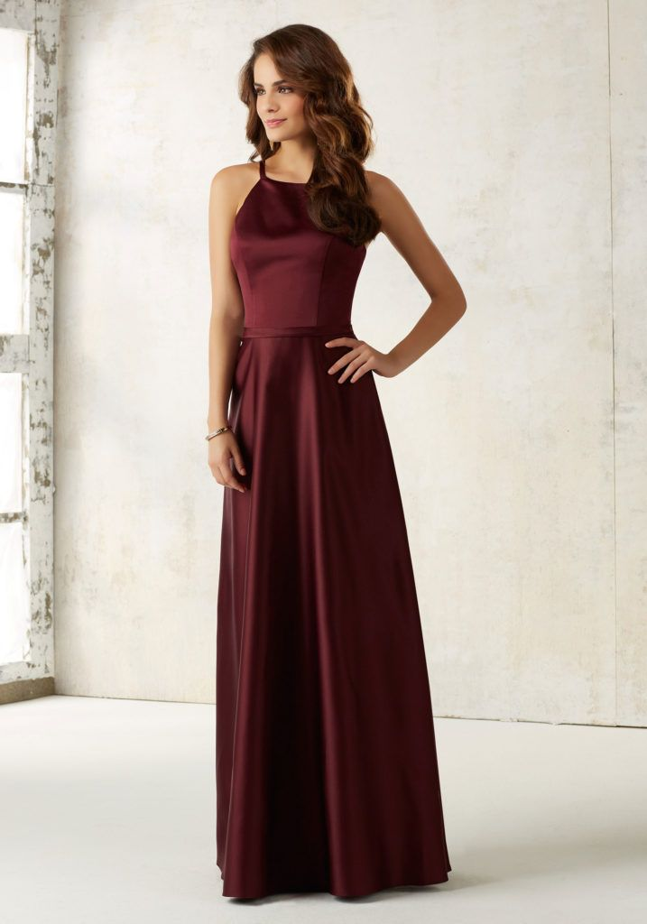 Sleek Satin Bridesmaids Dress Features a Matching Satin Waistband and Hidden Side Pockets. Zipper Back. Shown in Bordeaux