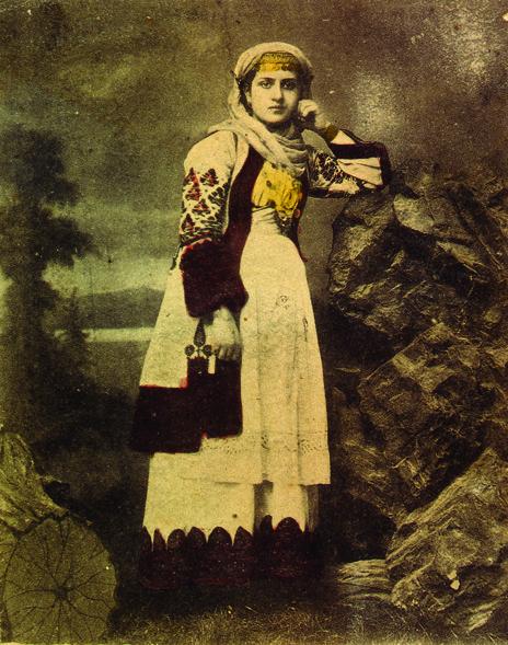 Postcard of a woman wearing a costume of Attica Greece. Early 20th century © Peloponnesian Folklore Foundation, Nafplion, Greece