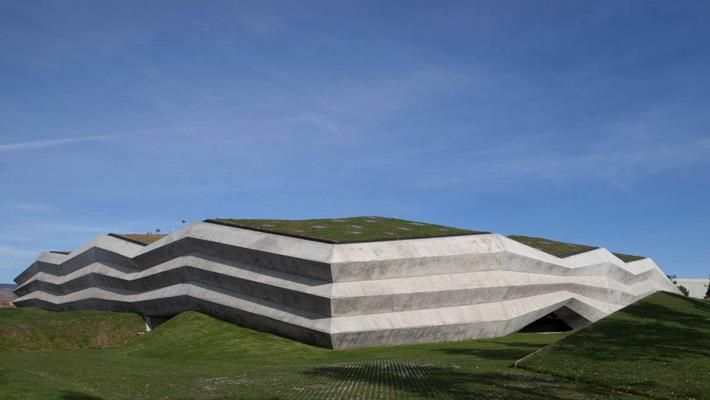 Folded Concrete Shell Wraps Coffee Production Plant By Giorgi Khmaladze Architects In Tbilisi In 2020 Factory Architecture Architect Green Roof